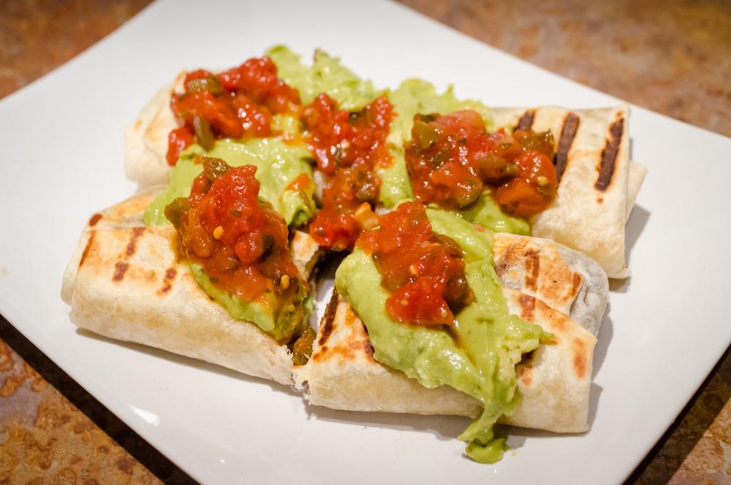Crispy vegan burritos on the plate, ready to eat!