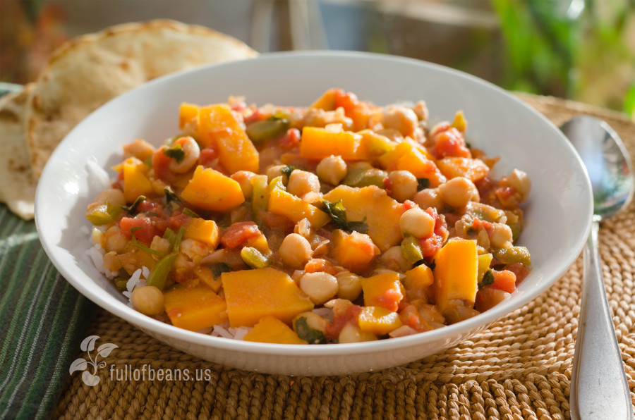 Delicious Chickpea and Sweet Potato stew served on rice with flat bread