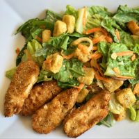 Air Fryer cooked Gardein Crispy Tenders with salad on a plate